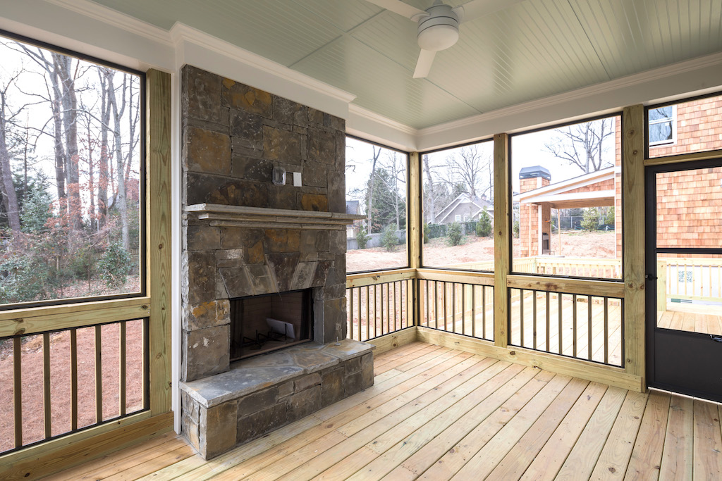Cozy up to your new outdoor fireplace in a Rockhaven home