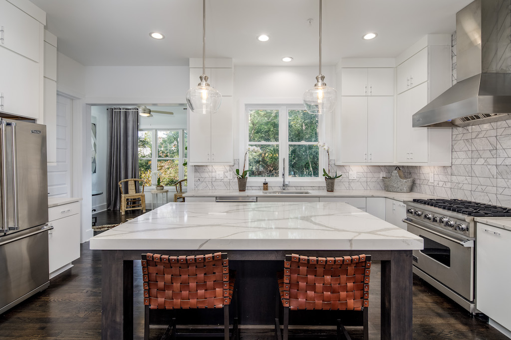 The kitchen of our new model home boasts stunning details throughout