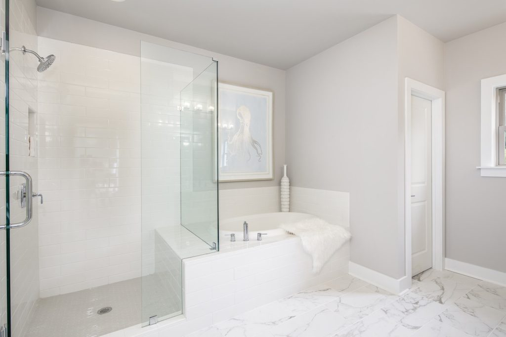 Shades of white, gray, and ivory can help you create a tranquil bathroom environment.