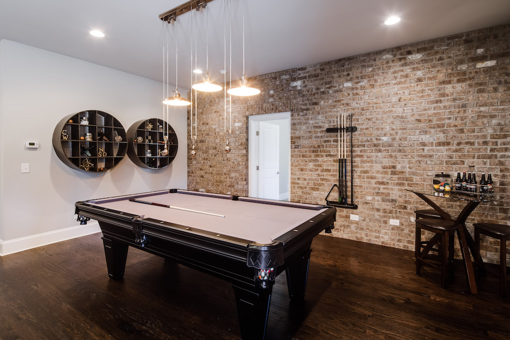 The brick texture in this Park Chase basement adds the perfect hint of industrial charm.