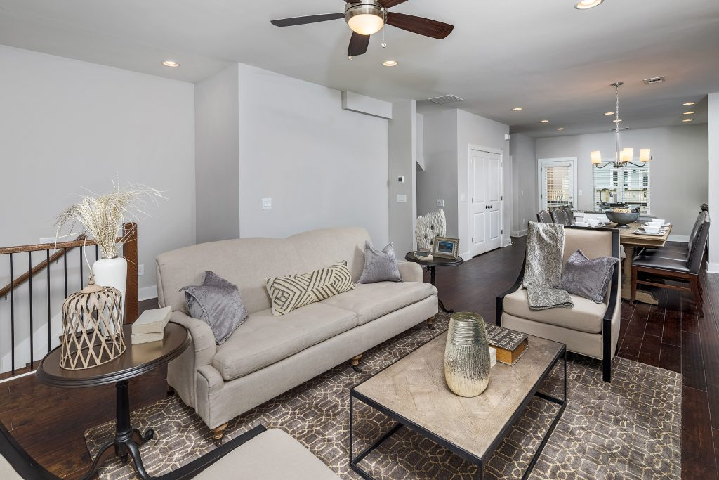 A living room in one of the new townhomes available in Eastland Gates