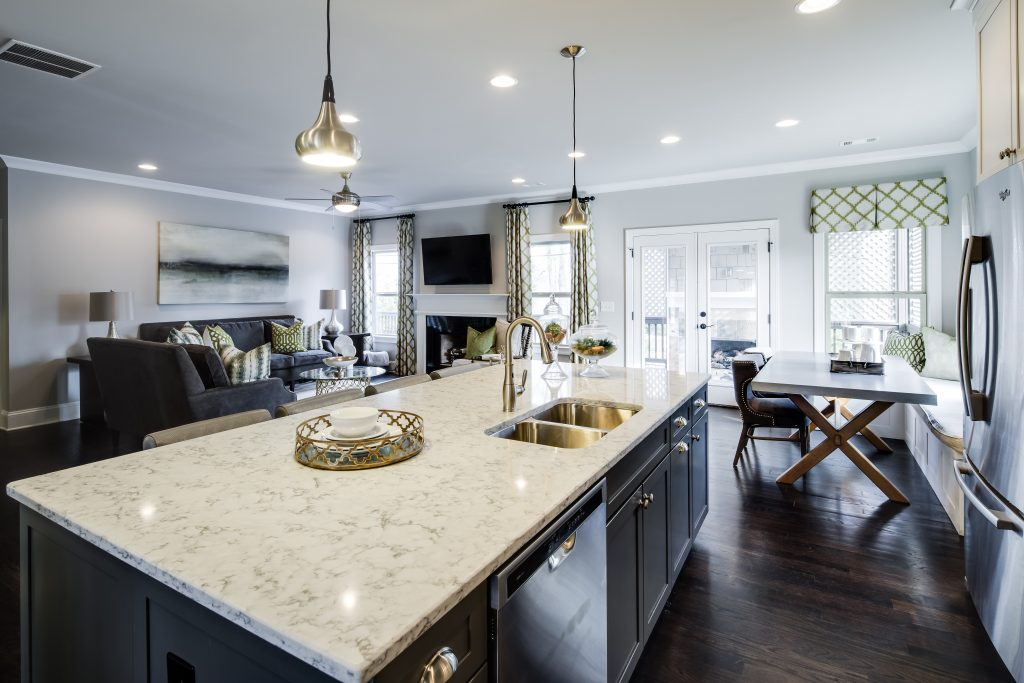 A kitchen island with sink in Park Chase