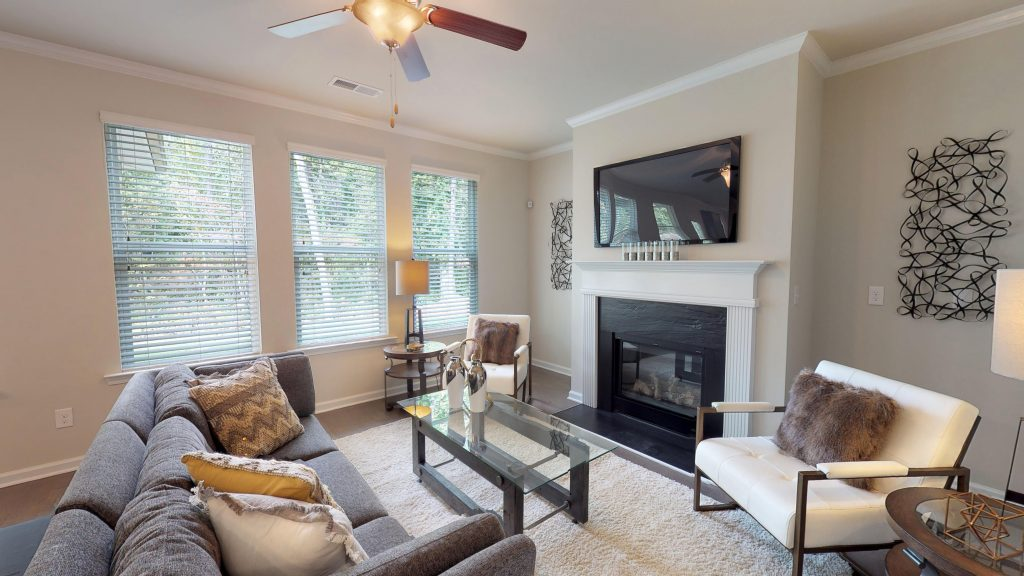 Decorating can be part of care for hardwood floors - seen here in Wynbrook floor plan home