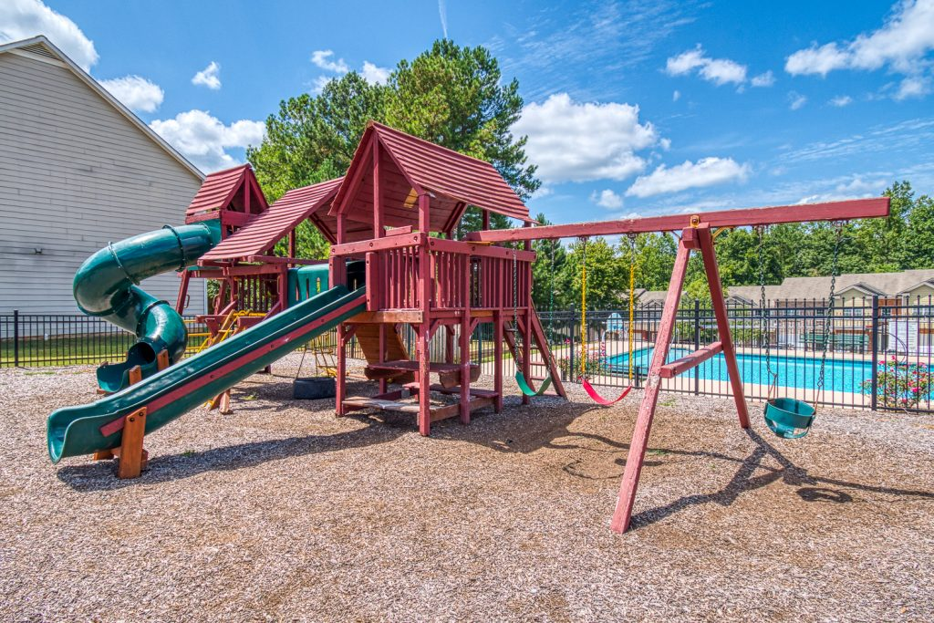 Playground area near community pool - High Grove has quality amenities