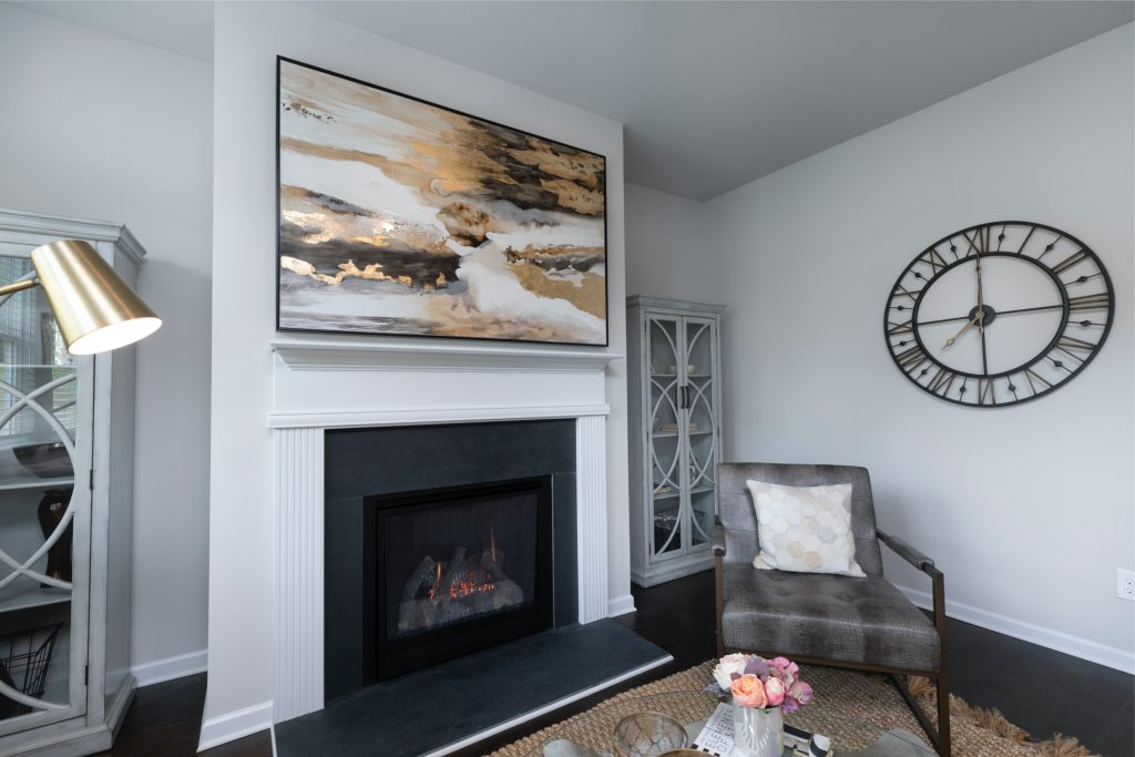 Fireplace in the living room at Lakeview at Stonecrest - The Summit single family homes