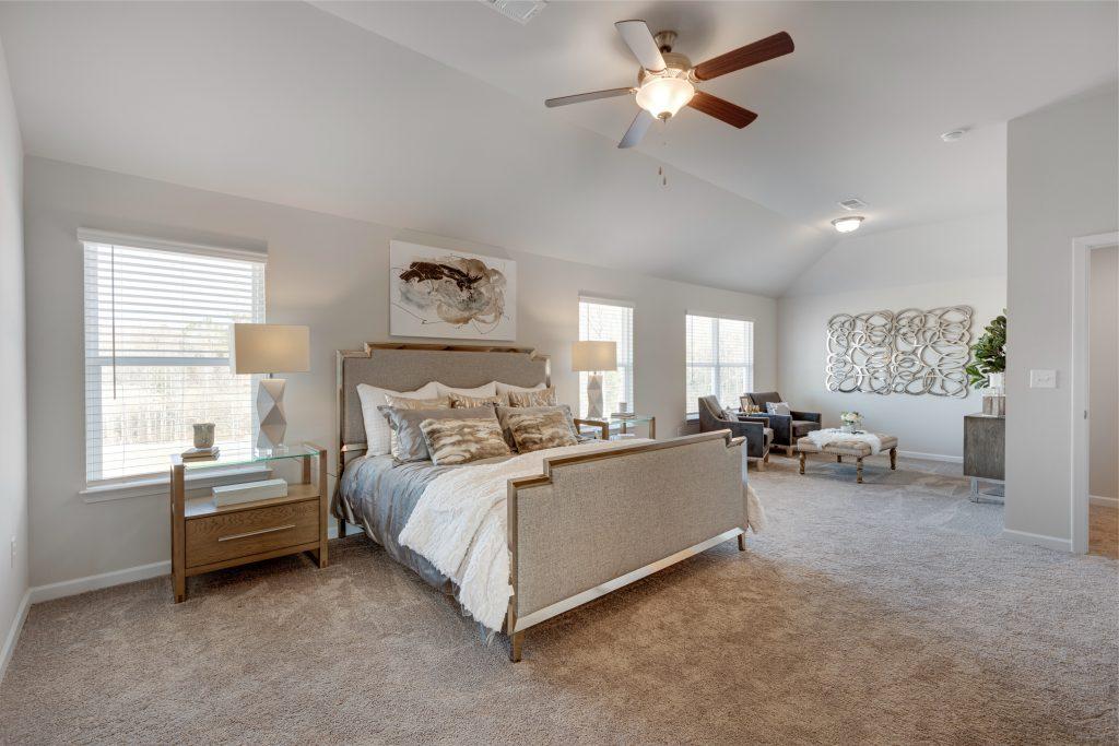 An owner suite bedroom in Trinity Park