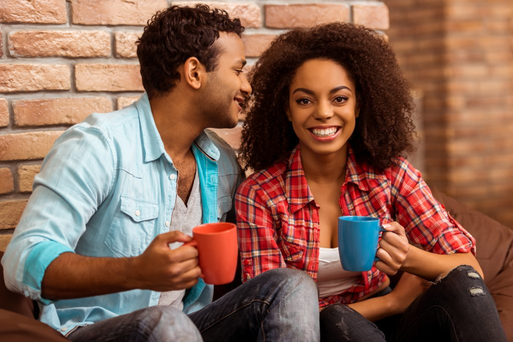 Couple drinking coffee on the front porch